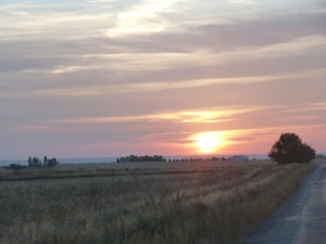 The sunrise behind Hermanillos on the Meseta