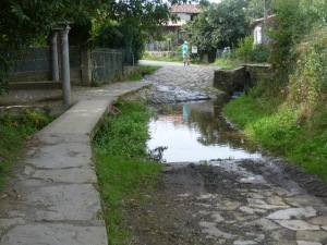 The water interrupts the regular pathway, so locals have built an alternative walkway.