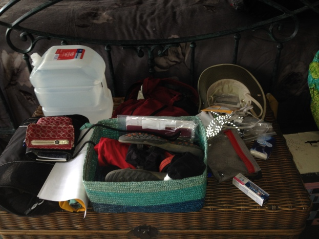 A basket of items to wear and for my day pack