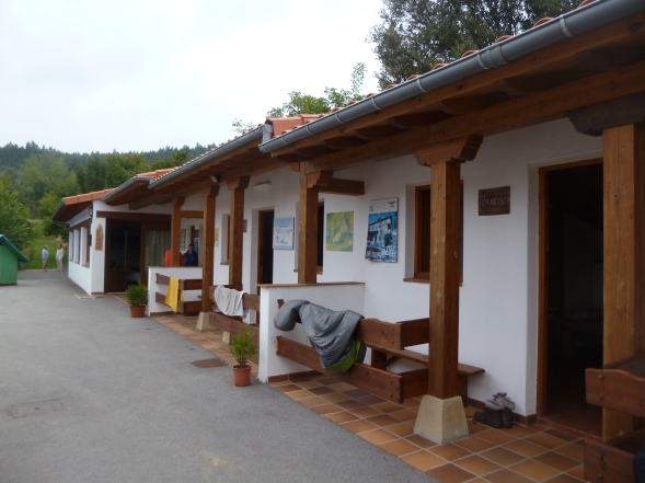 I'm in this row, the one with the open door, at the Albergue de Peregrinos in Guemes