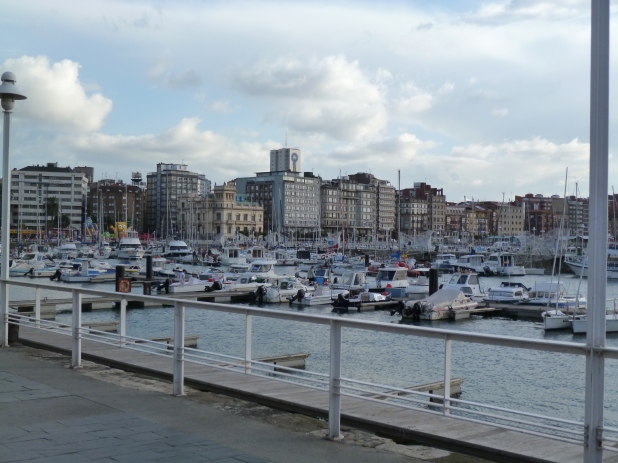 The Gijon harbor against a big city skyline